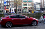 Red Tesla Model S on Amsterdam canal (Photo David van der Mark 2014)